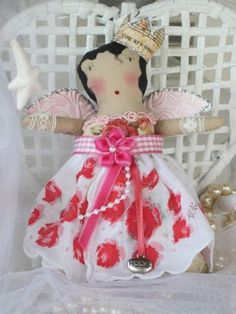 Vintage style dolly with rose hanky, wings and crown