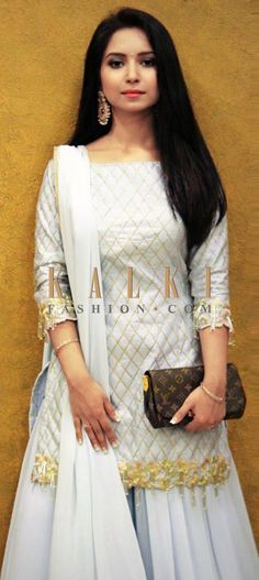Light blue raw silk top is styled with a criss cross check pattern embroidered in zari.The hemline features tassels and beads with floral patterns Palazzo Suit, Beautiful Suit, Wedding Preparation, Lace Border, Sharara, Indian Attire, Floral Patterns, Punjabi Suits, Light Purple