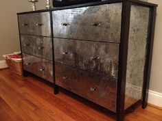 DIY mirrored (mercury glass effect) dresser (made with glass, black spray paint, grey spray paint, and Krylon looking glass spray paint.