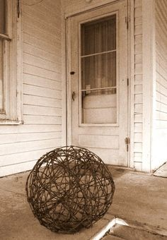 I will be happy to make you a barbed wire tumbleweed very similar to this. This awesome rusty sphere is one hefty tumbleweed; weighing in at about 12 pounds or so. It looks great inside or out. The tumbleweed makes a perfect trellis in a garden for plants to grow up and around. It can