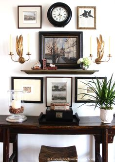 Gorgeous dining room gallery wall (love those sconces!)