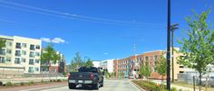 """Transit Village"", Boulder Colorado: medium density mixed use development primed for future commuter rail corridor - handles buses, cars, bikes, pedestrians and mega-pickup trucks today."