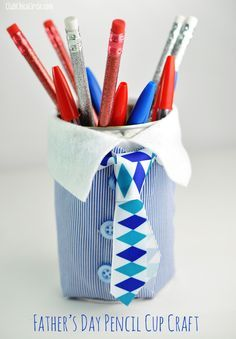 Father's Day Upcycled Can Pencil Cup Homemade Gift Idea from Club Chica Circle.  Father's Day is just around the corner, and if you are looking for a fun and easy craft for the kids to create, you will love this upcycled can turned into a cool suit and tie pencil holder.