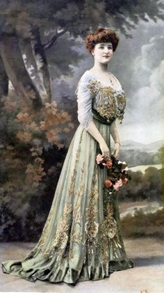 Hand tinted photograph (maybe an actress in her costume?) heavily embroidered and embellished on the skirt and front bodice