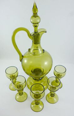 Hand blown green glass liqueur decanter and glasses poss. by Theresienthal or Bohemian glassworks, 19th-20th Cent.
