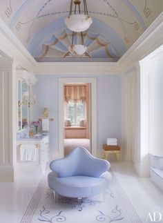 In a Virginia house decorated by Bunny Williams, the master bath's barrel…
