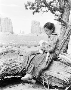 dancechasedance: Navajo Indian in Monument Valley. North Window-tree on right. Joyce Betty. [By Josef Muench]