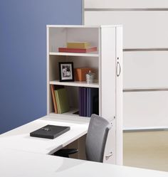 Cantilevering a desk from a storage tower is a space saver?