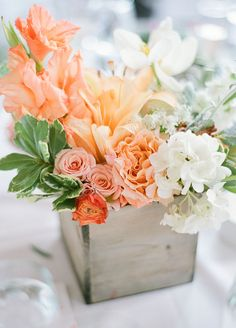 The couple chose a bright peach color scheme, for a fun yet sophisticated flair. Take a look at this fabulous outdoor wedding. #WeddingCenterpiece #WeddingFlowers