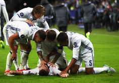 Dani Carvajal is congratulated by his team mates after scoring his team's third goal during the UEFA Super Cup match between Real Madrid and Sevilla at Lerkendal Stadion on August 9, 2016 in Trondheim, Norway.