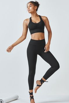 This all-black look makes a major statement with sexy and breathable mesh straps and a flattering high-rise legging with a new 7/8 length.