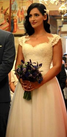 This is a real bride from a real greek wedding. Her name is Anna and she is rocking two things: simple and elegant. Dress is by Ourania Kay