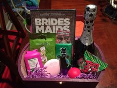 Will you be my bridesmaid? How I asked my girls! My DIY Maid of Honor/Bridesmaid box. Filled with a mini champagne bottle, Bridesmaid the movie, a cucumber mask, hand sanitizer, EOS lotion, EOS lip balm, fingernail polish (in wedding colors), a pack of gum and can't forget about the ring pop!  Painted boxes in wedding colors and added each girls initial to the top. Completely in love with how they turned out!
