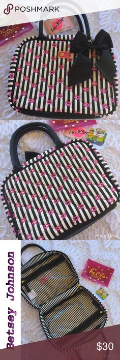 """Betsey Johnson Weekender Betsey Johnson Weekender  Black, White Stripe with Fushia lips Measures approx 12""""H x 9""""W x 3""""D  Dual rolled handles with 5.5"""" drop  Gold tone hardware  Double zippers  2 waterproof clear vinyl zip pockets inside  Lots of room for an overnight getaway to stash your swimsuit & toiletries - the zipped pouches are perfect for wet items or to protect your tablet  Protective PVC bottom Betsey Johnson Bags Cosmetic Bags & Cases"""