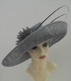 20b4de84ac601 Large sloop brim hat with large feather flower in pewter grey. Wedding Hats  ...