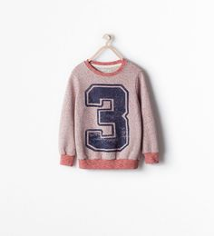 PLUSH NUMBER SWEATER $25.90