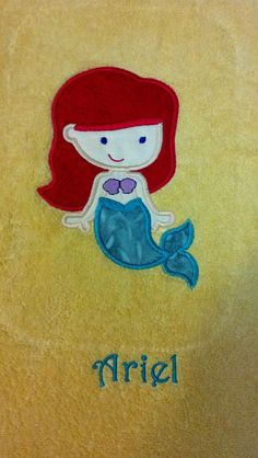 Applique and embroidery on towel. One of several centered around the princesses. LynniePinnie.com embroidery design