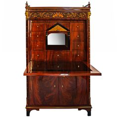 Rare Biedermeier Secretaire: DATE OF MANUFACTURE:	 1815 MATERIALS:	 Mahogany Veneer with Palisander, Maple, & Ebonized Accents. Featuring Original Ormolu Mounts H. 63"