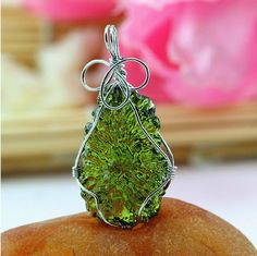 "Moldavite is a tektite and is the only ""extraterrestrial"" gemstone, which is found only in the Moldau Valley in Czechoslovakia. Moldavite is associated with the"