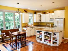 This kitchen has cheery yellow walls and hardwood floors. The Edelweiss - Plan 1013. http://www.dongardner.com/plan_details.aspx?pid=2699. #Kitchen #Yellow #Home