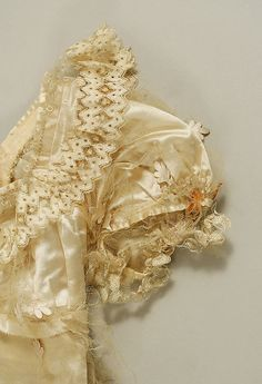 Evening dress ca. 1814 - probably silk satin and net. Elaborate lace on the collar. - in the Metropolitan Museum of Art costume collections.