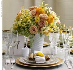 Get lush, luxe centerpieces with a vintage hobnail vase filled with safari roses, hydrangeas, yellow ranunculuses, gloriosa lilies, and narcissus.    Place settings by Party Rental Ltd.; Event design and flowers by Michelle Rago LTD.