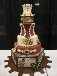 This could easily go in 'Things I Think Are Pretty', but since it's steampunk, it goes here. Isn't this just a wonderful cake? I love the gears and the pocket watch. I think I'm getting more of a crush on steampunk stuff.