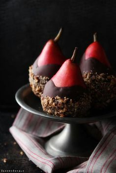 Red pears dipped in chocolate dipped in almond crunch
