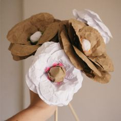 Learn how to make these pretty paper flowers for your table.