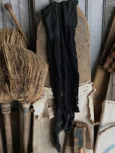 Ladies primitive old long black stockings at Sweet Liberty Homestead. Perfect for your prim laundry room or hang from a drying rack or old country cupboard door or chair.
