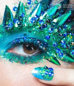 Here ya go, freaks. Get your green and blue drag queen mood on and poke your cornea with this catastrophe.
