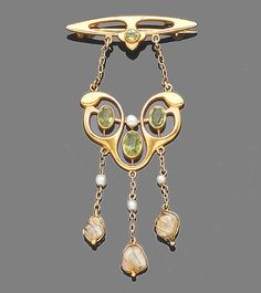 A peridot and pearl brooch, circa 1900  The openwork surmount set with a circular-cut peridot, suspending two trace-link chains, terminating in an openwork cartouche highlighted with oval-cut peridots and a seed pearl, to three further trace-link chains, each set with a seed pearl and terminating in a freshwater pearl within a wire frame, pearls remain untested, length 7.0cm.