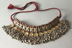 An antique katesari silver choker from Uttar Pradesh (India). tikka: a red dot painted at the center of each one of the pendants, set with clear glass over a golden colored foil. India Jewelry, Tribal Jewelry, Silver Jewelry, Silver Rings, Jewellery, Bohemian Jewelry, Estilo Tribal, Women Jewelry, Fashion Jewelry