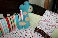 Whimsical pattern mixing in this #red and #aqua crib bedding.  #nursery #polkadotcribsheet