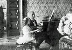 Gabriel Fauré playing a duet with Mlle Lombard, 1913.