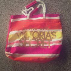"Victoria's Secret Canvas Beach Bag ""In love with Victoria's Secret"" canvas beach bag.  Beautiful summer colors! Victoria's Secret Bags Totes"