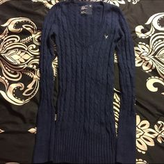 Navy long deep v neck sweater AE (XS) Navy blue with grey logo, deep v neck sweater from American Eagle. Size XS, good condition. American Eagle Outfitters Tops