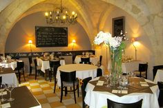 Where to dine in Uzès? Maybe under the golden arches in Place aux Herbes, shaded by the broad sycamore branches in the square. Enjoying 'feu de bois' pizzas on a cobbled streets or a pretty terrace. Savouring French cuisine at .