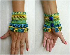 Unique beaded crochet bracelet cuff in yellow, light green and turquoise blue .  This bracelet crochet from 100% merserized cotton thread, is decorated with glass seed beads, preciosa beads, miyuki beads, crocheted mini flowers and turquoise stone. Тhe beads are variants of green, blue and yellow colors. The bracelet is made with the high-end beads. The lower part of the bracelet are decorated with beaded crochet mini flowers .  I made this cuff by using a Free Form Crochet Technique and a…