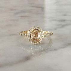 Oval Yellow Sapphire and Yellow Gold Halo Engagement Ring at Sarah O. Jewelry | Denver, CO