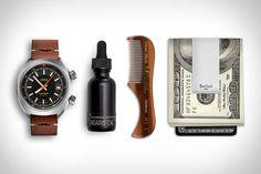 Oris Movember Edition Watch <> Cold Springs Apothecary Beard & Face Oil <> Kent Moustache Comb <> Berluti Money Clip.