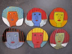 Floating Faces: ceramic plates
