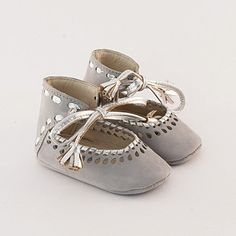 Grey leather baby shoes with silver leather braiding and cutout embellishment. $55.00, via Etsy.