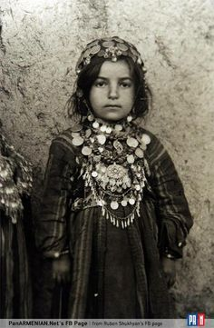 A small Armenian girl, covered with juwelry and amulets.  East-Anatolia, ca. 1900-1915.