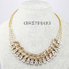 Lyxig 18k guldpl�terad halsband med massa srasstenar