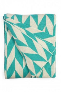 """Fab Habitat features knitted cotton throws in vivid colors and patterns. From renowned Metro collection, these throws are certain to keep you warm from the cold of winter and add a perfect accent to your sofa or bed.    Measures: 70"""" x 50""""   Turquoise Natural Throw Blanket by Fab Habitat. Home & Gifts - Home Decor - Pillows & Throws Fairfield, Connecticut"""