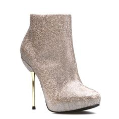 i love these boots they remind me of disco balls. a grown up version funky element to incorporate with jeans or leather