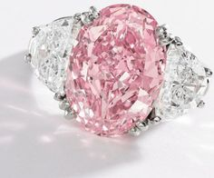 Pink diamond and diamond ring, Oscar Heyman and Bros. Center stone: an oval-shaped Fancy Intense Pink diamond weighing approximately carats, flanked by carats of white diamonds. Via Diamonds in the Library. by JustcallmeLOVE Pink Diamond Engagement Ring, Pink Diamond Ring, Diamond Jewelry, Engagement Rings, Pink Sapphire, Most Expensive Engagement Ring, Diamond Necklaces, Uncut Diamond, Diamond Heart