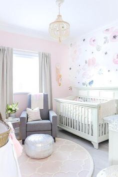 A Cream Beaded Chandelier Hangs Over Round Pink Trellis Rug Ad Illuminates Gorgeous Ivory