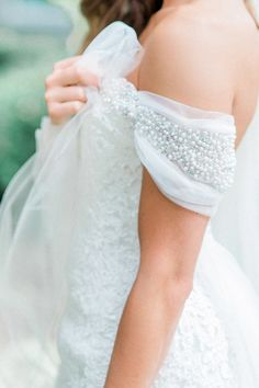 Pearl detailed wedding dress sleeve: http://www.stylemepretty.com/2016/02/12/elegant-romantic-atlanta-spring-wedding/ | Photography: Carla Gates - http://www.carlagatesphotography.com/